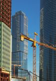 The lifting crane and buildings Royalty Free Stock Images