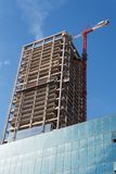 Lifting crane and high building under construction Royalty Free Stock Photos