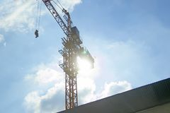 Lifting crane of reverse solar with blue sky Stock Photo