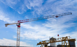 Lifting crane under blue sky Royalty Free Stock Image