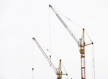 Lifting cranes Stock Images
