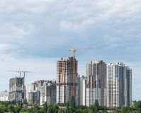 Lifting cranes and building under construction Stock Photo