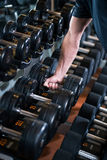 Lifting dumbbell Stock Images