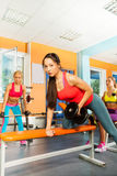 Lifting dumbbell weights on the bench exercise Royalty Free Stock Photos