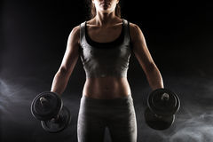 Lifting the dumbbells Royalty Free Stock Image