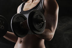 Lifting the dumbbells royalty free stock photography