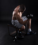 Lifting dumbbells Stock Image