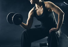 Lifting the dumbbells Royalty Free Stock Photo