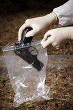 Lifting evidence of handgun Royalty Free Stock Photography