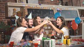 Lifting Glasses in Confetti Shower stock footage