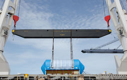 Lifting heavy equipment on ships. stock photos
