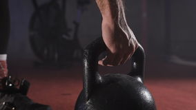 Lifting heavy weights by hand close-up. stock footage