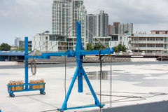 Lifting hoist operating on roofing top., Mobile hoist Royalty Free Stock Image