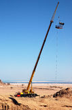 Lifting/hoisting crane Royalty Free Stock Images