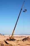 Lifting/hoisting crane. Loaded with floodlight for film shooting. Photo taken in desert near Sharm-Elshaih, Egypt Royalty Free Stock Images