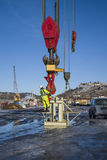 Lifting hook to taklift. Taklift, a giant seagoing crane with a lifting capacity of up to 400 tons at 45 meters, compared to the man on the picture you can see Stock Photography