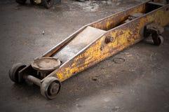 Lifting jack yellow long used. Royalty Free Stock Image