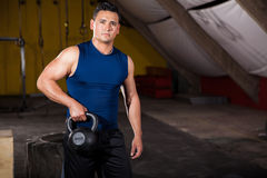 Lifting kettlebell in a gym Royalty Free Stock Images