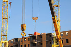 Lifting of the load in the construction of high-rise Royalty Free Stock Photo