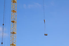 Lifting of the load in the construction of high-rise Royalty Free Stock Photography