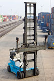 Lifting machine in container area. Crane work its job in the container storage area Stock Photo