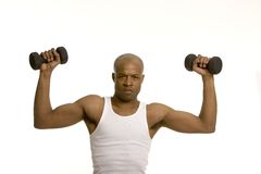 lifting man weights Στοκ Φωτογραφίες