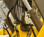 Lifting mechanism of loader. Hydraulic lifting cylinder of the yellow forklift Royalty Free Stock Image