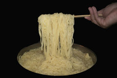 lifting noodles with chopstick Stock Image