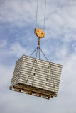 Lifting pallet with formwork elements by crane Royalty Free Stock Image
