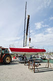 Lifting sailing boat in the water. With crane in the harbour Royalty Free Stock Photography