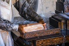 Lifting Salt Tiles. Lifting raw salt tiles – Somewhere near Quaidabad, Khushab, Punjab, Pakistan Royalty Free Stock Images