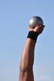 Lifting Shot Put. Man Lifting Shot Put at a Track and Field Meet Royalty Free Stock Images