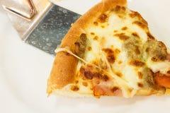 Lifting slice of pizza Stock Photos