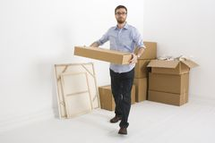 Lifting a small box Stock Photo