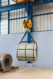 Lifting steel coil Stock Photo