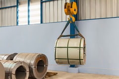 Lifting steel coil Stock Image