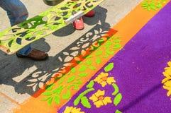 LIfting stencil off Holy Week carpet, Antigua, Guatemala Stock Photography