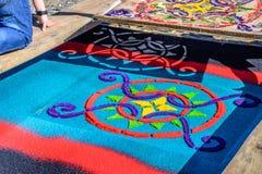Lifting stencil off Lent carpet, Antigua, Guatemala Stock Images