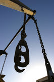 Lifting Tackle. WA shot of industrial lifting hook & chains royalty free stock image