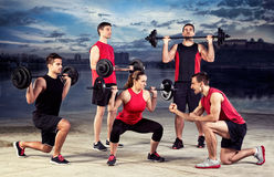 Lifting training with trainer Royalty Free Stock Photo