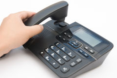 Lifting up a telephone receiver Royalty Free Stock Photos