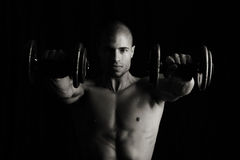 Lifting weights Stock Images