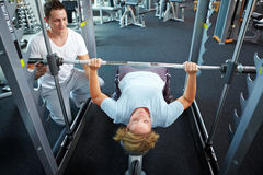 Lifting weights with personal Royalty Free Stock Photo