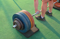 Lifting weights. Strong man lifting weights light Stock Images