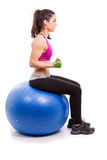 Lifting weights on swiss ball Stock Images