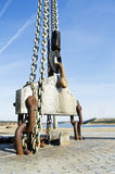 Lifting winch. Industrial lifting winch with chains and beam Stock Photography