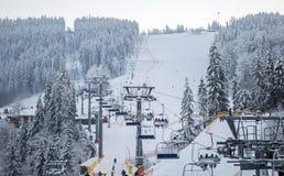 Lifts of the Bukovel ski resort. The theme of mountain sports, skiing, ski track 2A royalty free stock photo
