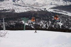 Lifts in the mountains. Above the snow Stock Photo