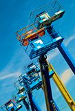 Lifts In The Sky. Construction lifts set against a vivid sky Royalty Free Stock Photography