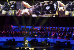 Ligabue in Concert. Ligabue singing and playing guitar with his band with a hudge TV screen during one of his concert in arena di Verona - Italy 2007 Stock Photos